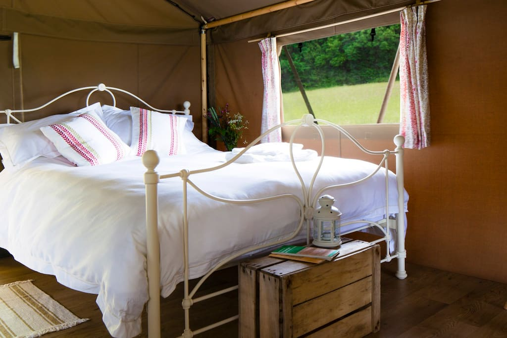 King bed with pure cotton bedding.