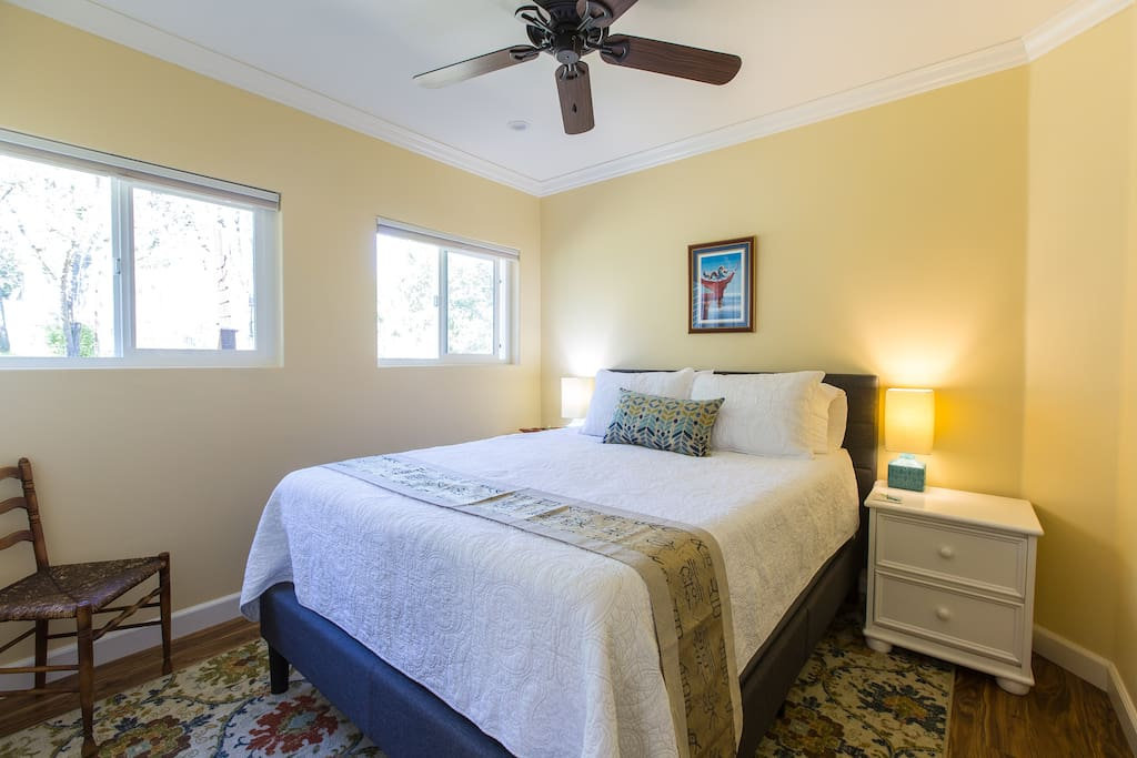 Bedroom #1 with queen bed and ceiling fan
