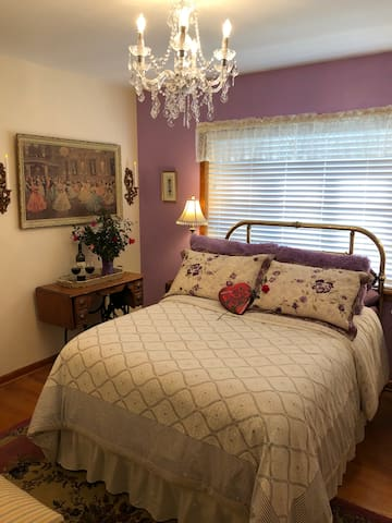 Our lovely French room; closet has hangers, luggage racks, flashlight, spa robes of several sizes, makeup mirror