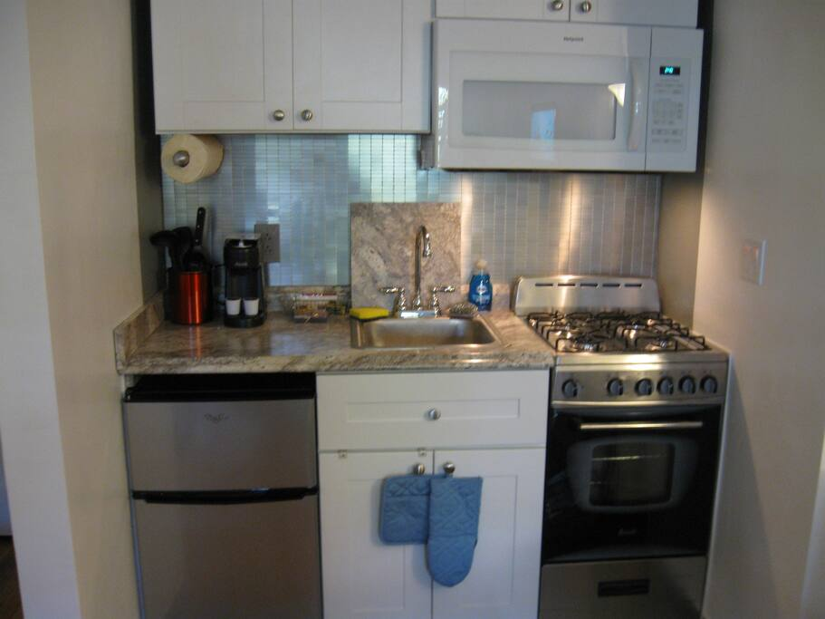 Full Gourmet kitchen with coffee maker, microwave oven, gas stove with conventional oven, an under counter refrigerator freezer and all the necessities to prepare your favorite meals.