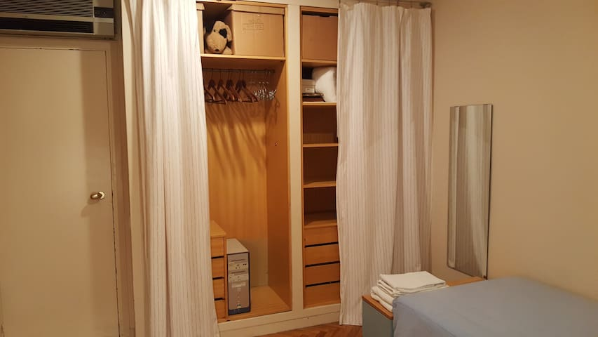 Wardrobe with hangers and drawer with key