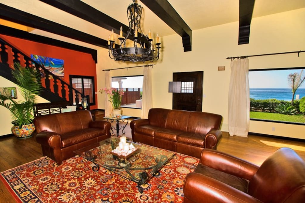 Comfortable living room has views and high beamed ceilings.