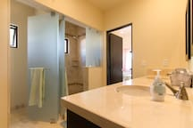 Bathroom attached to Queen bedroom with shower & two sinks