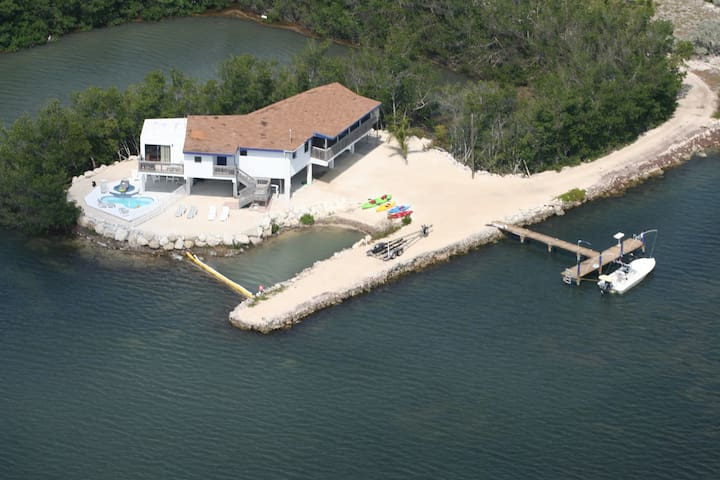 Completely private and secluded setting, heated pool & spa + boat dock with electric and water.