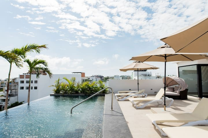 Stroll to the Beach from a Contemporary Loft with a Pool