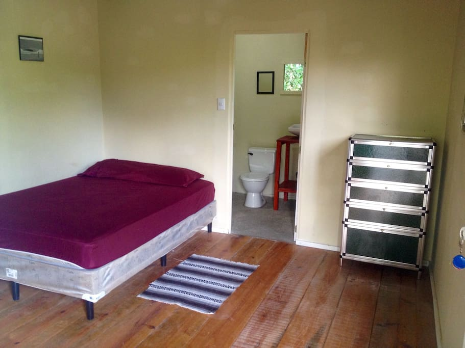 Single room upstairs with full size bed and bathroom with toilet and sink