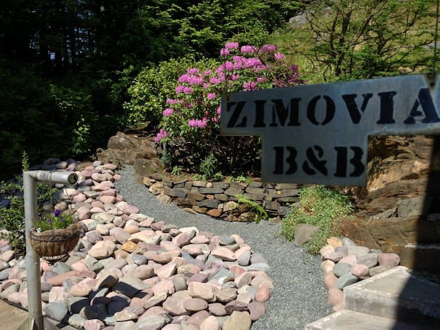 Sign hanging outside entrance to Garnet Room. Zimovia is the name of the Strait downtown Wrangell is situated on.