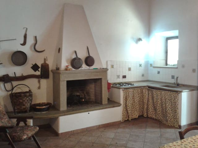 At Benedetto's three-room apartment in Tuscany