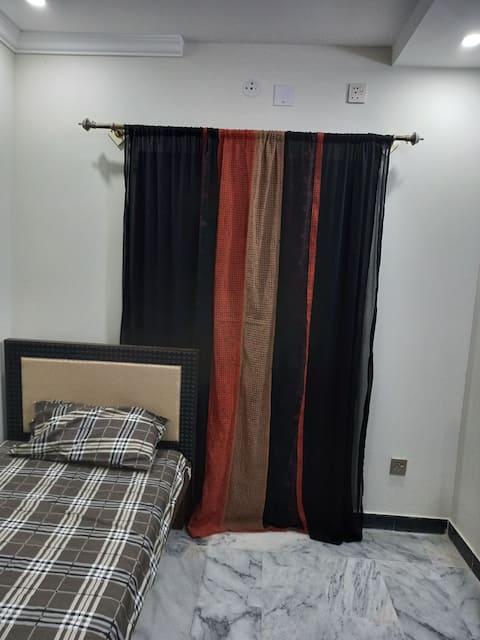 1- Bedroom for a single lady available in a secure residential area.