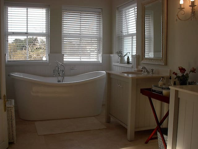 comfortable living bathrooms - both with bath and shower and double vanity