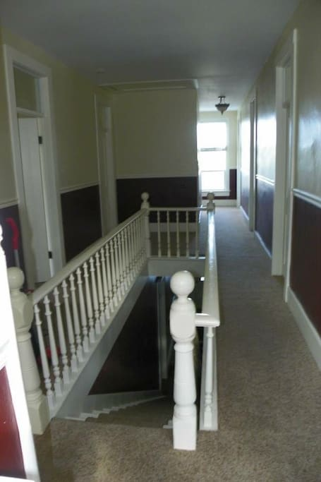 Upstairs has 7 bedrooms, one of which can fit 2 people. Downstairs has 2 bedrooms.