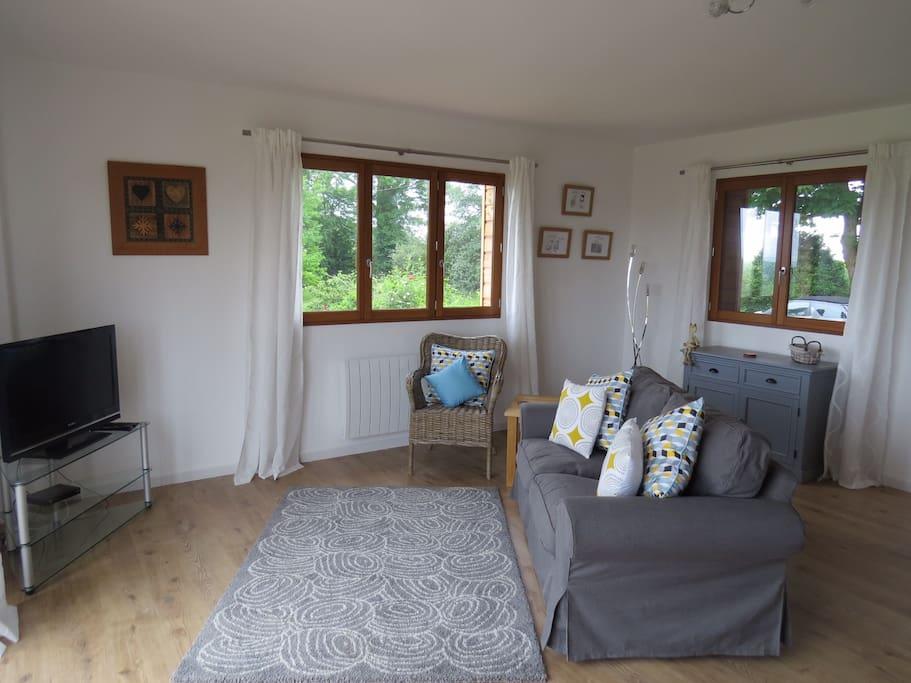 Lounge area with bi-fold doors onto balcony