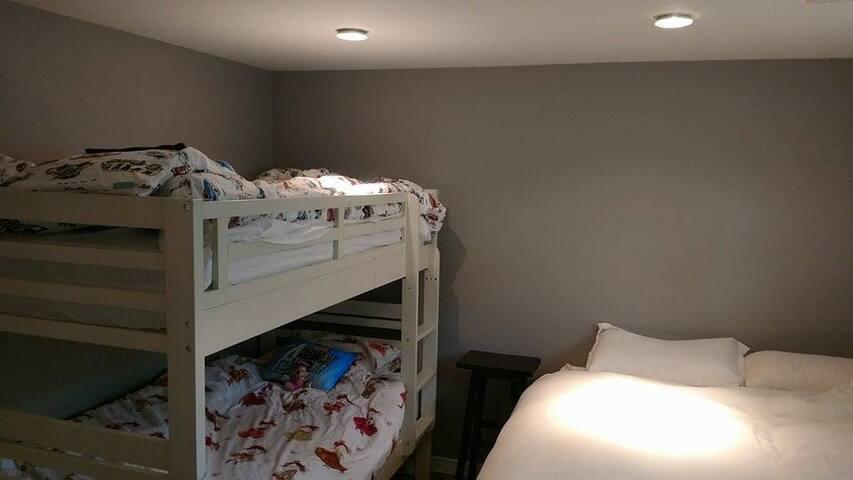 Bedroom: single bunks plus a queen bed