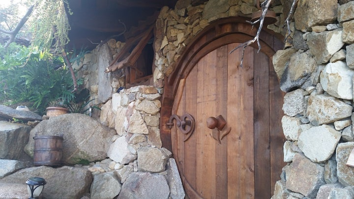 """Custom built, classic """"hobbit-style"""" round-door, made of Western Red Cedar, featuring one-of-a-kind locking system in real-life Hobbit House near San Diego, CA"""