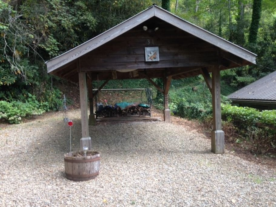 Carport and woodpile