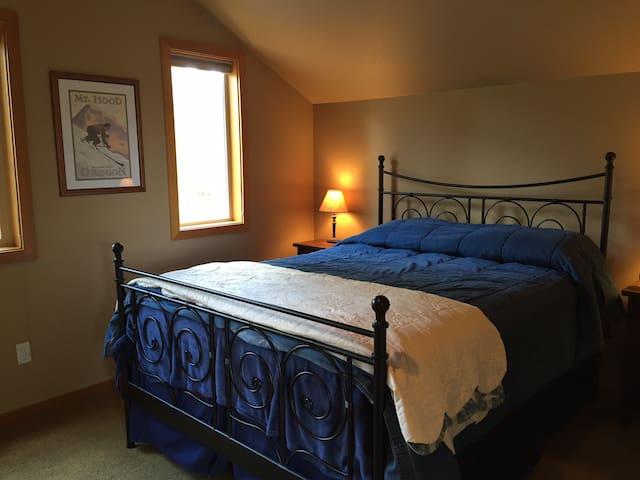 Cozy pillow top queen size bed
