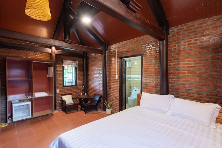 The second double room with full of basic amenities and a space for working and relaxing also