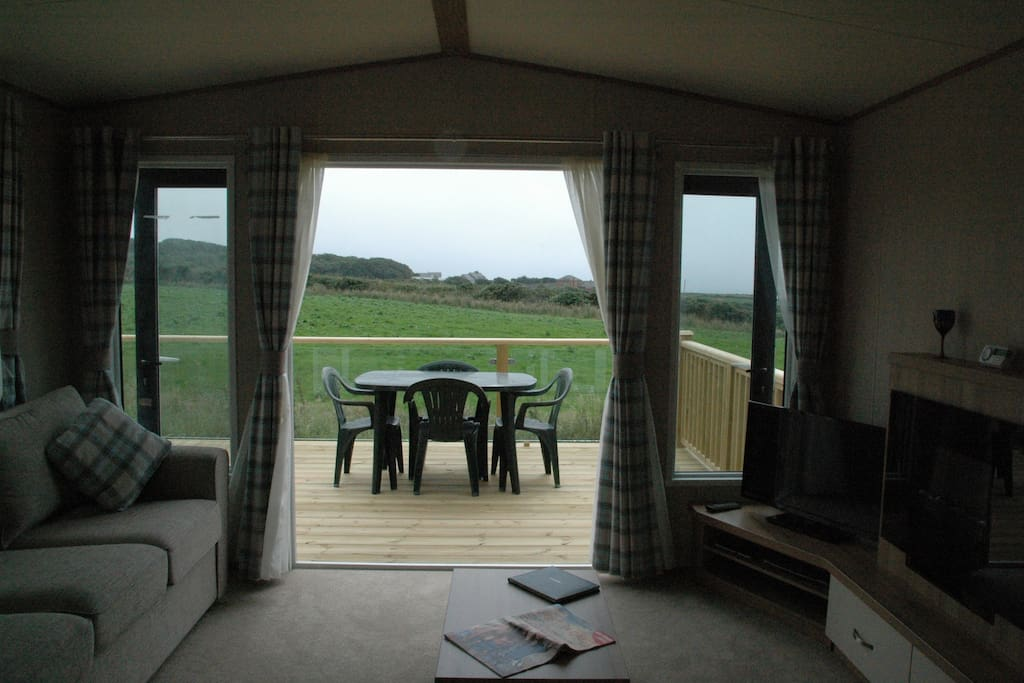 View from the living space towards the sea across open countryside