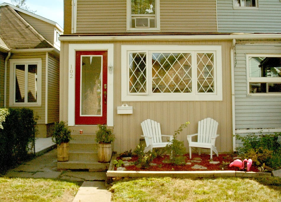 Front of the house including porch room windows and entrance plus muskoka chairs and rose garden directly in front. You are welcome to use them.