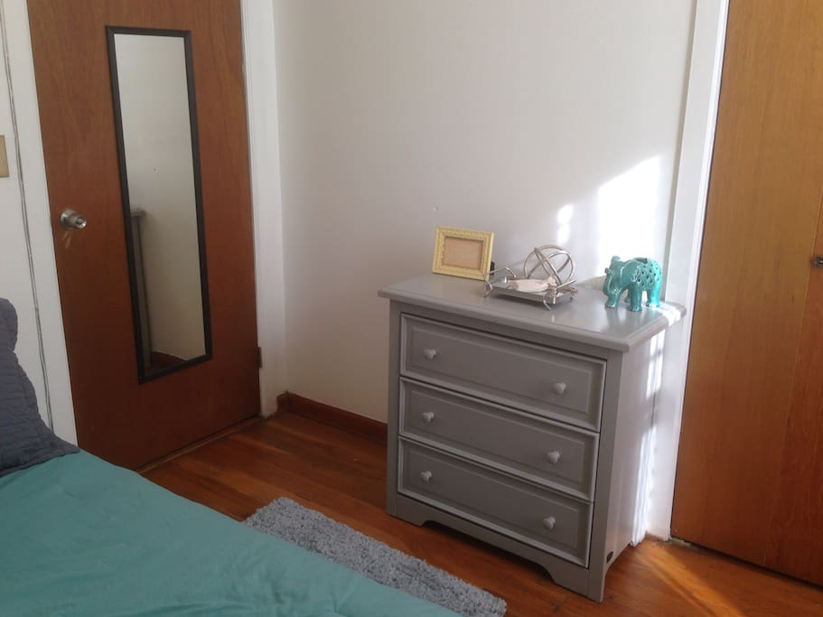Room gets amazing natural light.  3 drawer dresser with plenty of room for your clothes.