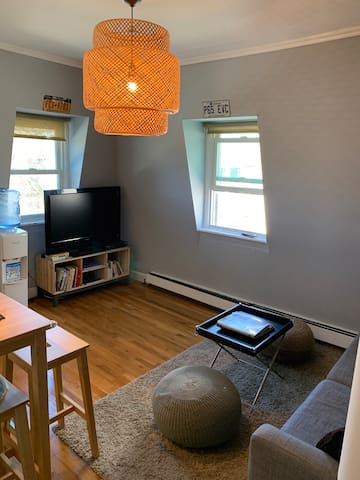 Enter open  living space with cable tv/google chrome/purified water dispenser/sofa/dining area