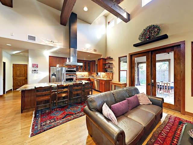 The kitchen and living room share an open floor plan that's great for larger groups or families.