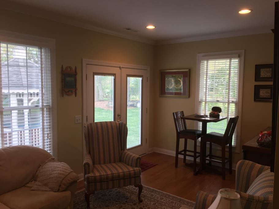 Another view of the living room and dinette set for 2