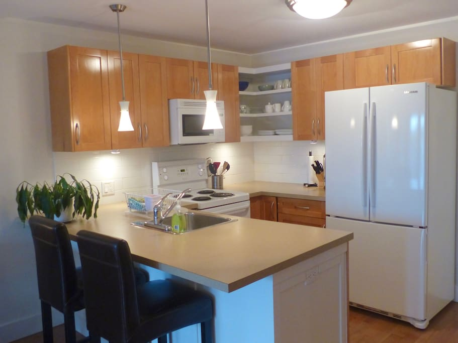 Kitchen is well stocked with microwave, stove, dishwasher French door fridge, toaster and kettle.