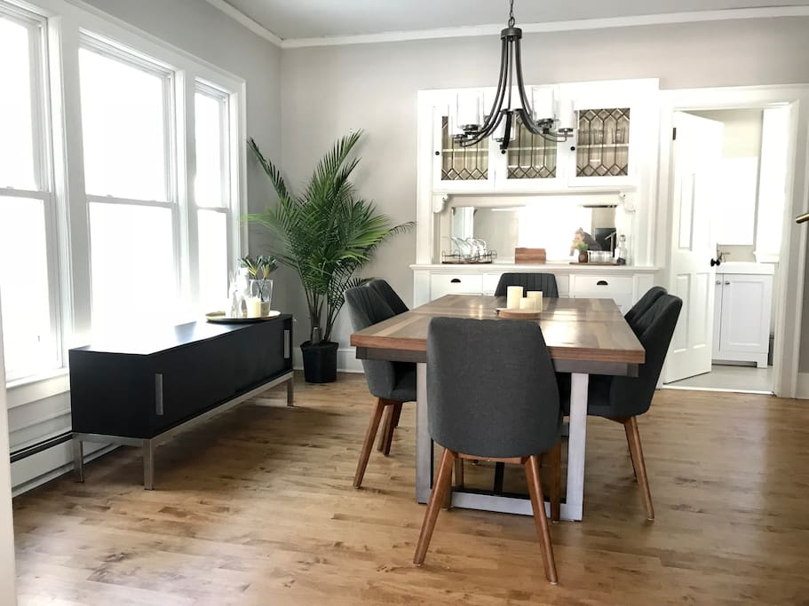 Elegant dining room with original built-in cabinetry from the early 1900's. Perfect for meals, laptops, board games - you name it!