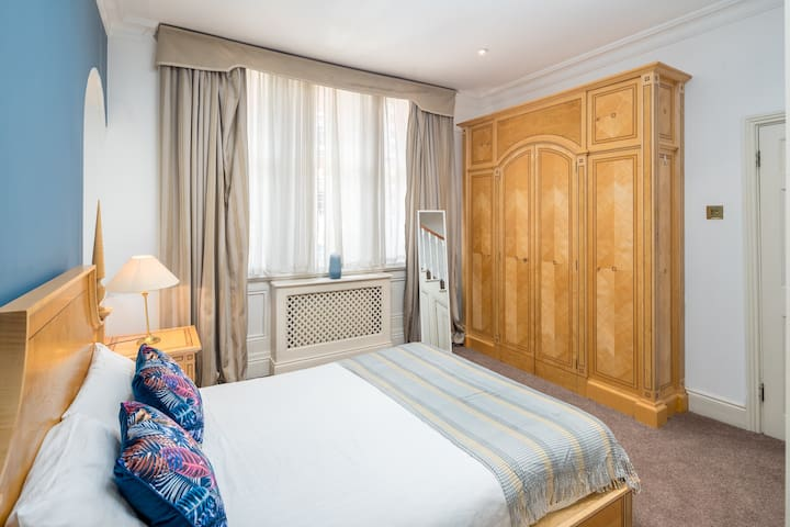 Lovely bedroom with ornate woodwork and ample storage space