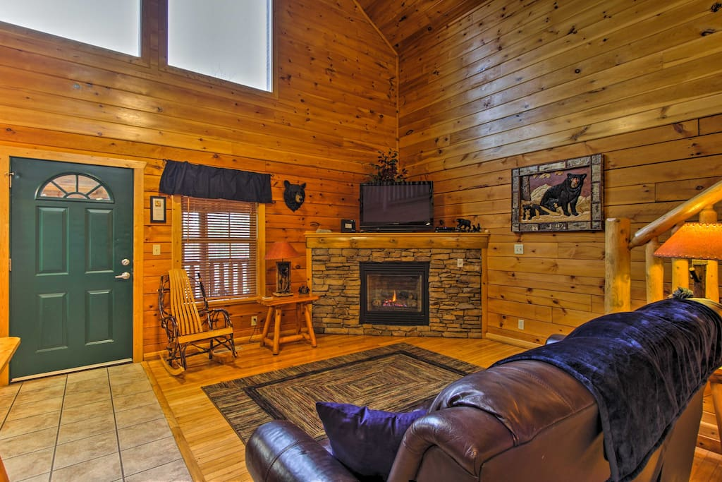 Unwind in the living area, complete with an electric fireplace, a flat-screen TV and a comfy couch.