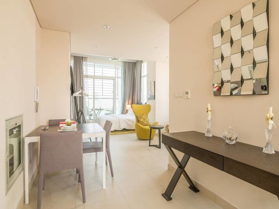 "Large 750 sqft studio apartment designed tastefully to host 4 guests. Review: ""It was my business trip and I really had peaceful time staying here. I wanted to go around Dubai for sightseeing and this apartment is really close to many places."", Essa"