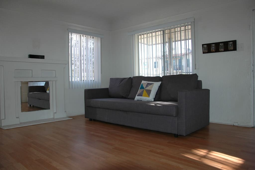 Spacious living area with a sofa bed and internet TV
