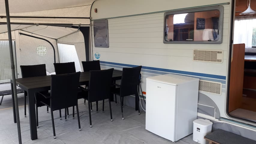 Large tent with dining area for six persons