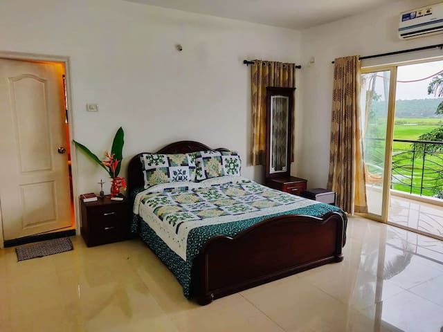 The beautiful master bedroom with an attached bath that shares the breathing view of nature at its best.