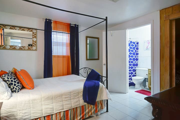 Queen Suite..Queen size bed and full bath. With a touch of The Island Flair.