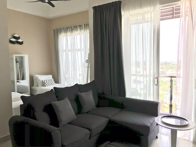 Living room with L-shape sofa.