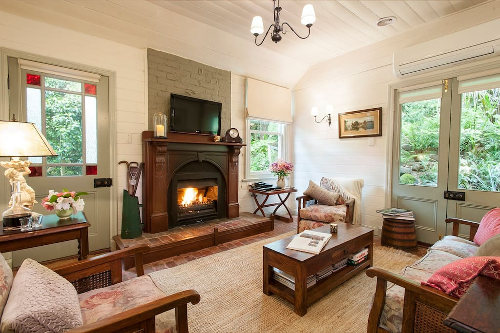 Cosy loungeroom with open fire in this historic cottage