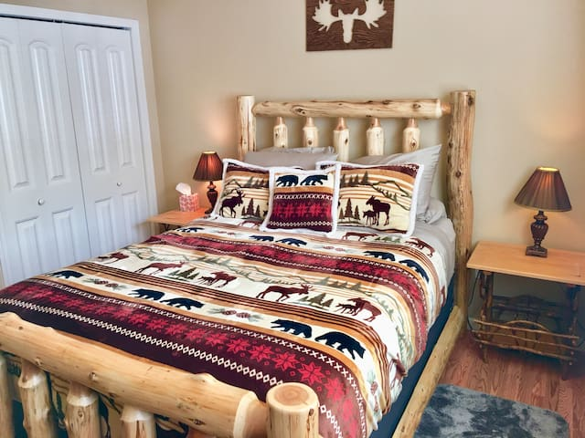 Log bed in master.   Wonderful new mattress.  You'll sleep like a dream.