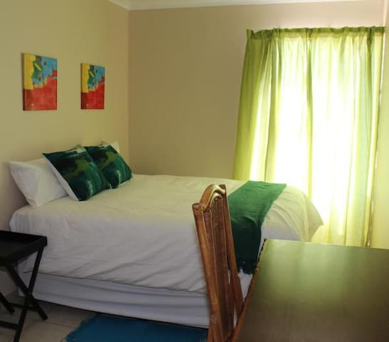 The Green room with a private bathroom, can accommodate up to 4 guests.