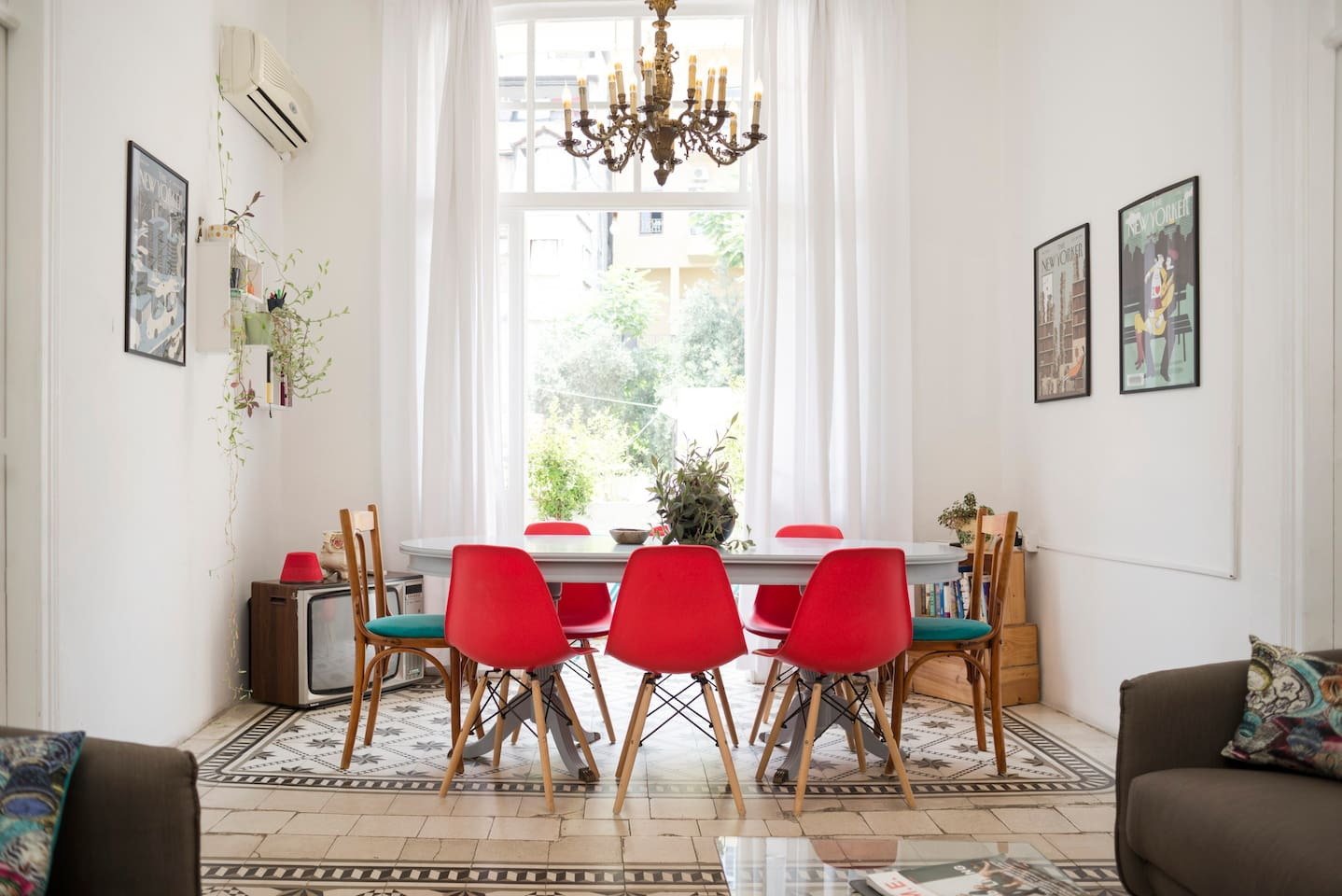 The apartment's high ceilings, large windows and tiled floors are typical of traditional Lebanese houses. The large dining table in the living room is perfect for dinner parties, while the balcony overlooking the cute café below is ideal for relaxing and getting some fresh air.