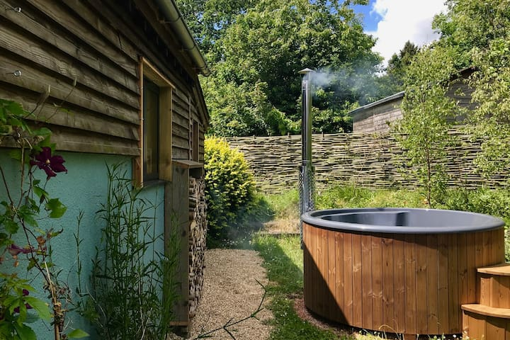 Wood fired hot tub in private surroundings
