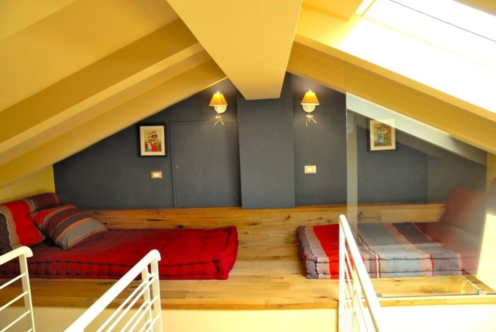 Single Mattress beds on the wooden floor of the attic space