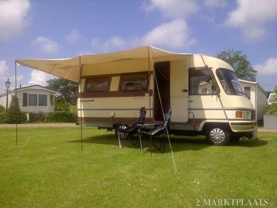 It has an extension canvas thsi was before the camper was painted the colour is now different