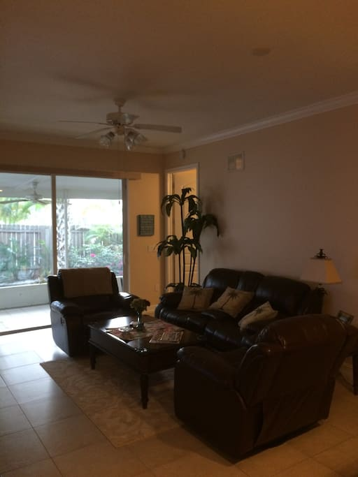 Super comfy living room with 4 reclining chairs and tommy bahama style tropical furniture with large TV and cable tv