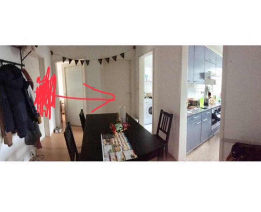 As soon as you enter the apartment, you'll see the dining table. The room rented will be the one pointed by the arrow.