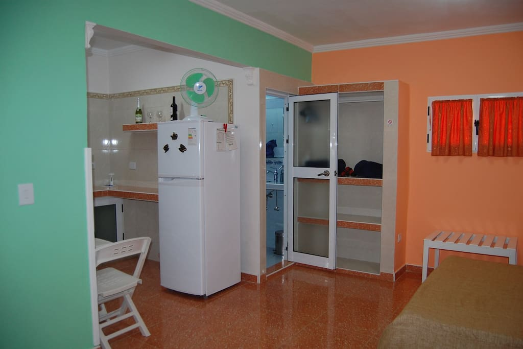 Partial view of the kitchenette and bathroom.
