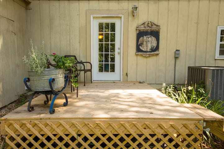 Your own private deck with a view of the woods behind the house and Fred, the groundhog that lives nearby and often comes to visit!