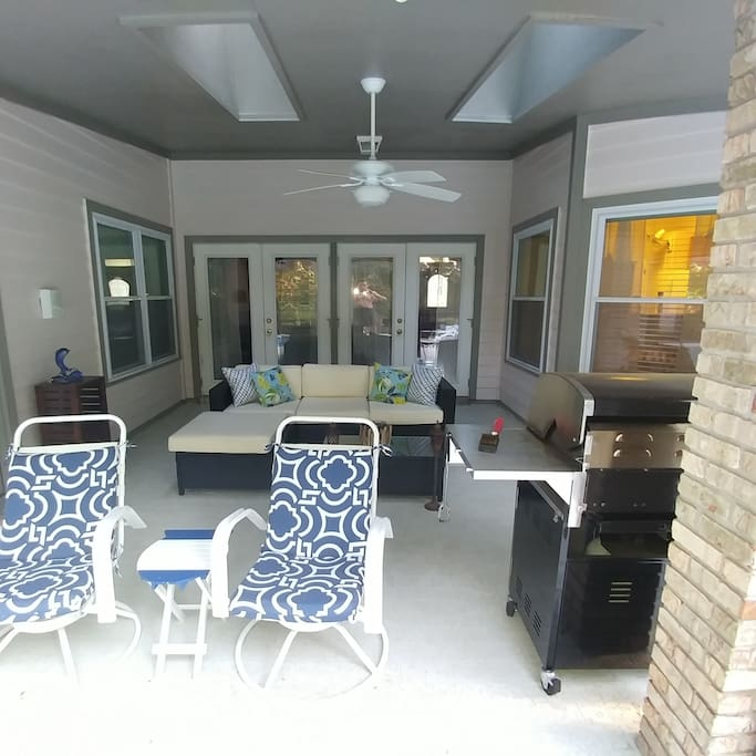 Covered outside patio with grill.