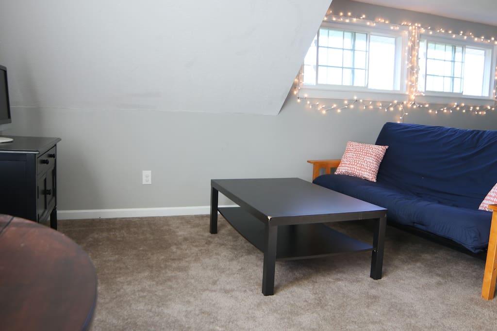 Futon and coffee table. Smartcast TV.